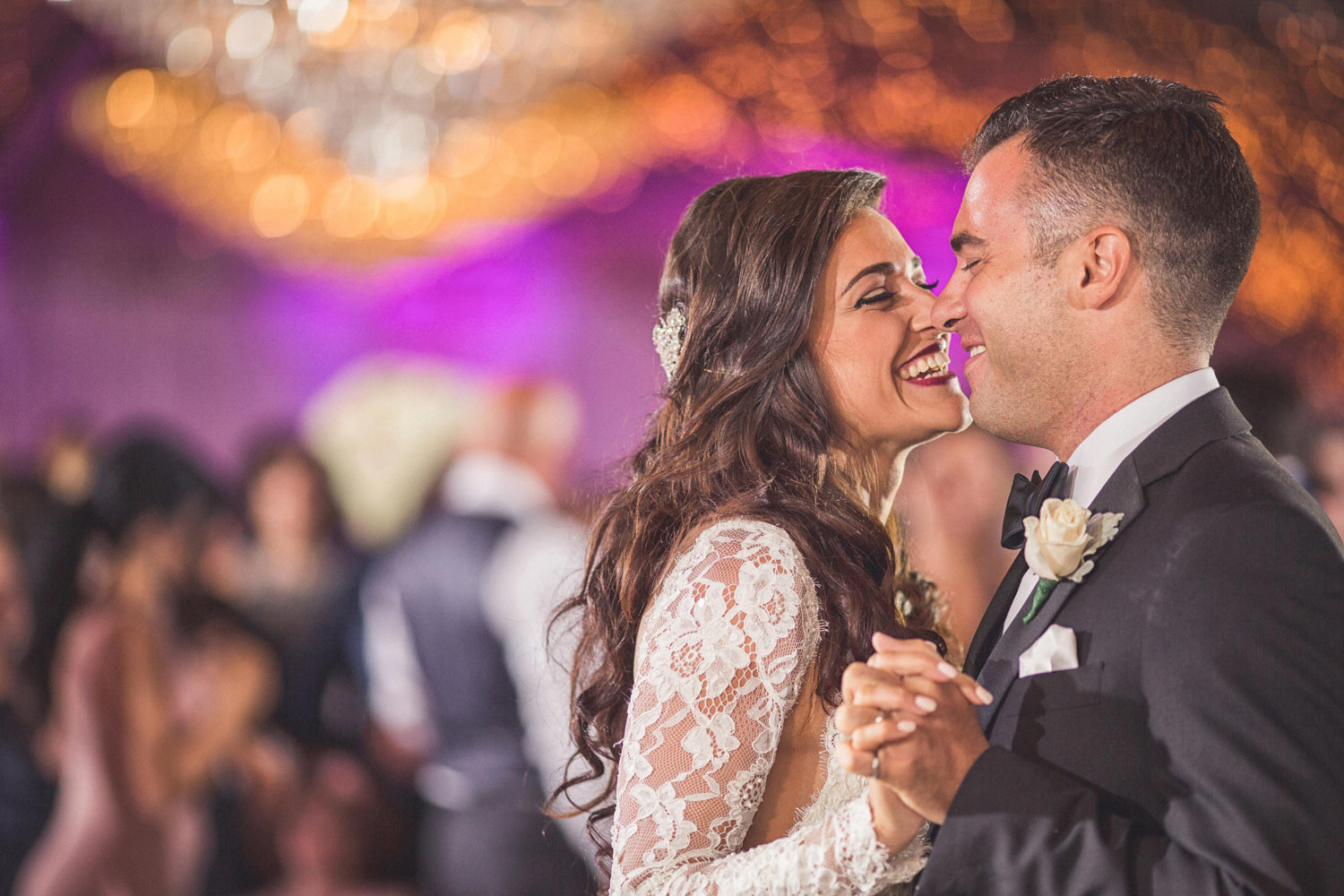 Capturing wedding moments are important especially during the bride and groom first wedding dance. El Caribe Country Club Caterers, Brooklyn, NY
