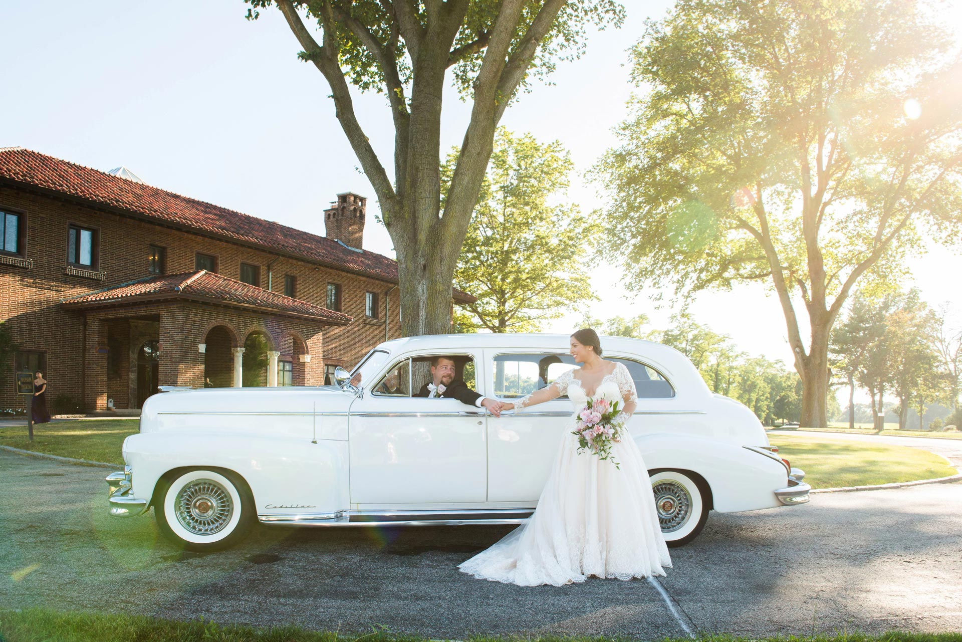 Bride and groom arriving in style at their wedding reception venue at the Village Club of Sands Point, NY